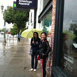 Two diehard bag ladies, waiting in the rain.