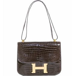 """<b>Hermes</b> Vintage Constance bag, <a href=""""http://www.matchesfashion.com/product/151845#"""">$26,996</a> at Matches"""