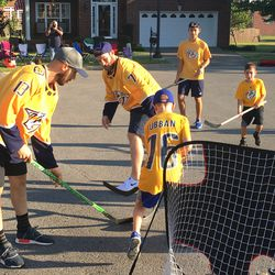 Nick Bonino and Yannick Weber mix it up with local hockey players during an intense game of street hockey in Nolensville.
