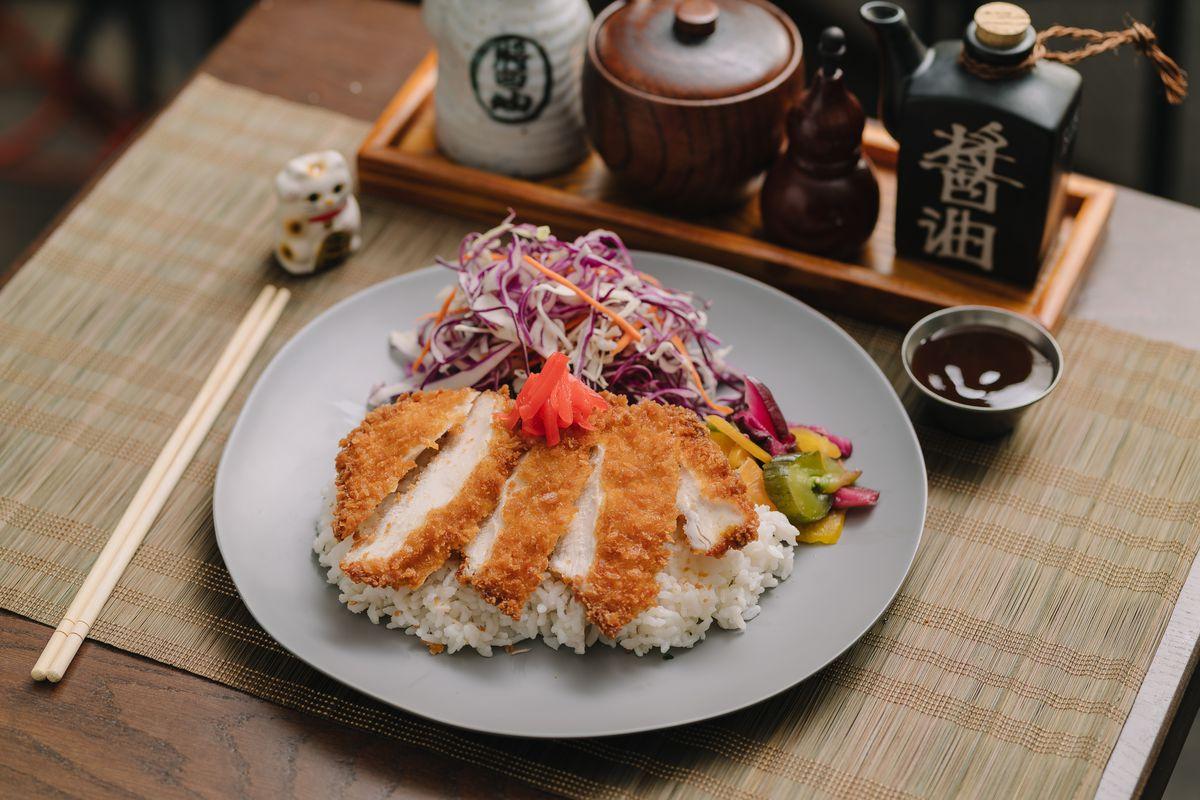 A katsu dish: breaded fried pork on top of white rice.