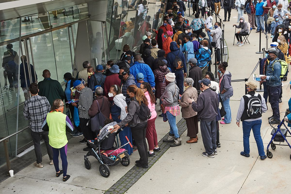 People wait in a long line outside the Brooklyn Museum to cast their ballots during the first day of early voting, Oct. 24, 2020.