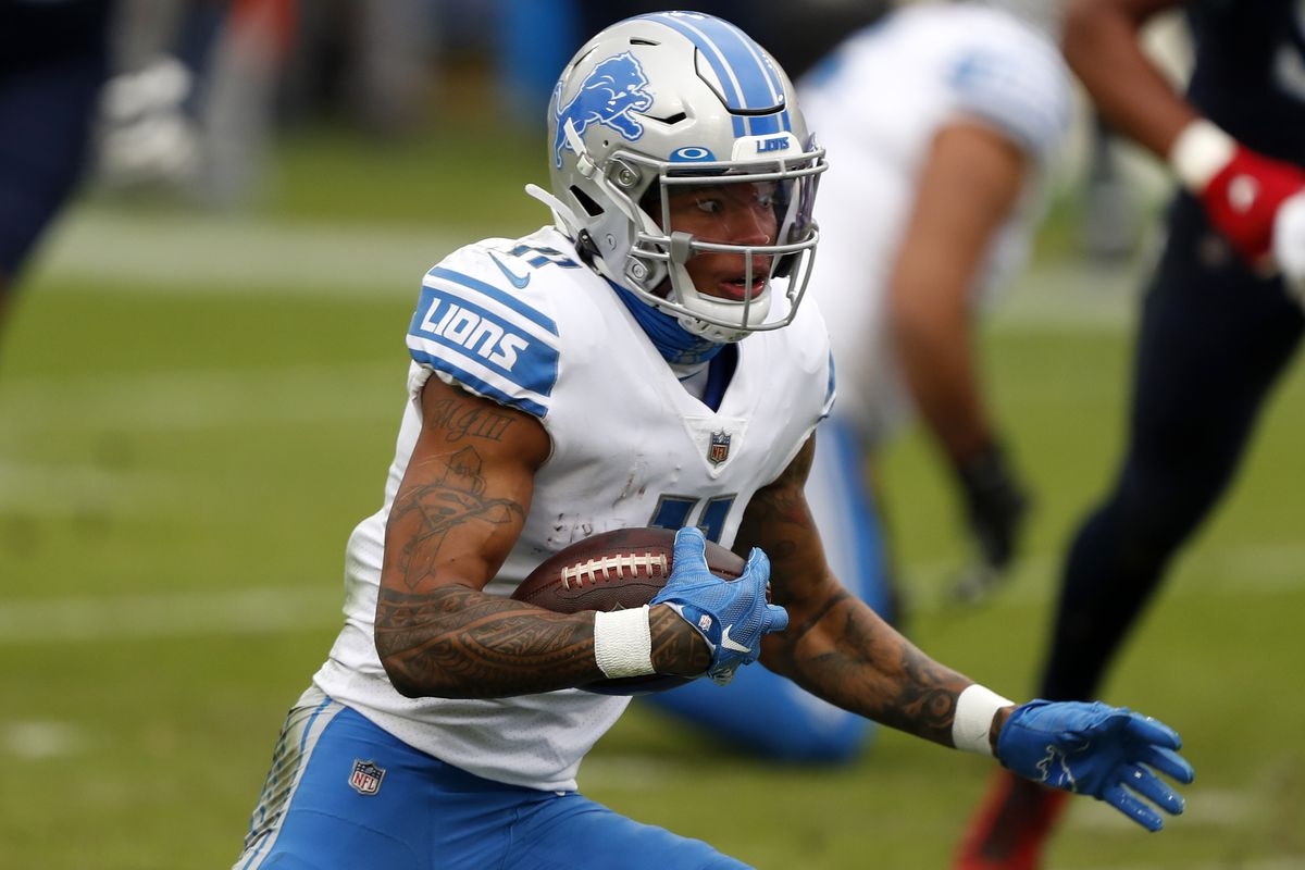 Wide receiver Marvin Jones #11 of the Detroit Lions carries the football against the defense of the Tennessee Titans during the second quarter of the game at Nissan Stadium on December 20, 2020 in Nashville, Tennessee.