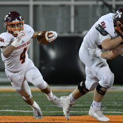 Brother Rice's Jessie Plunkett (4) runs away from the defense. Worsom Robinson/For the Sun-Times.