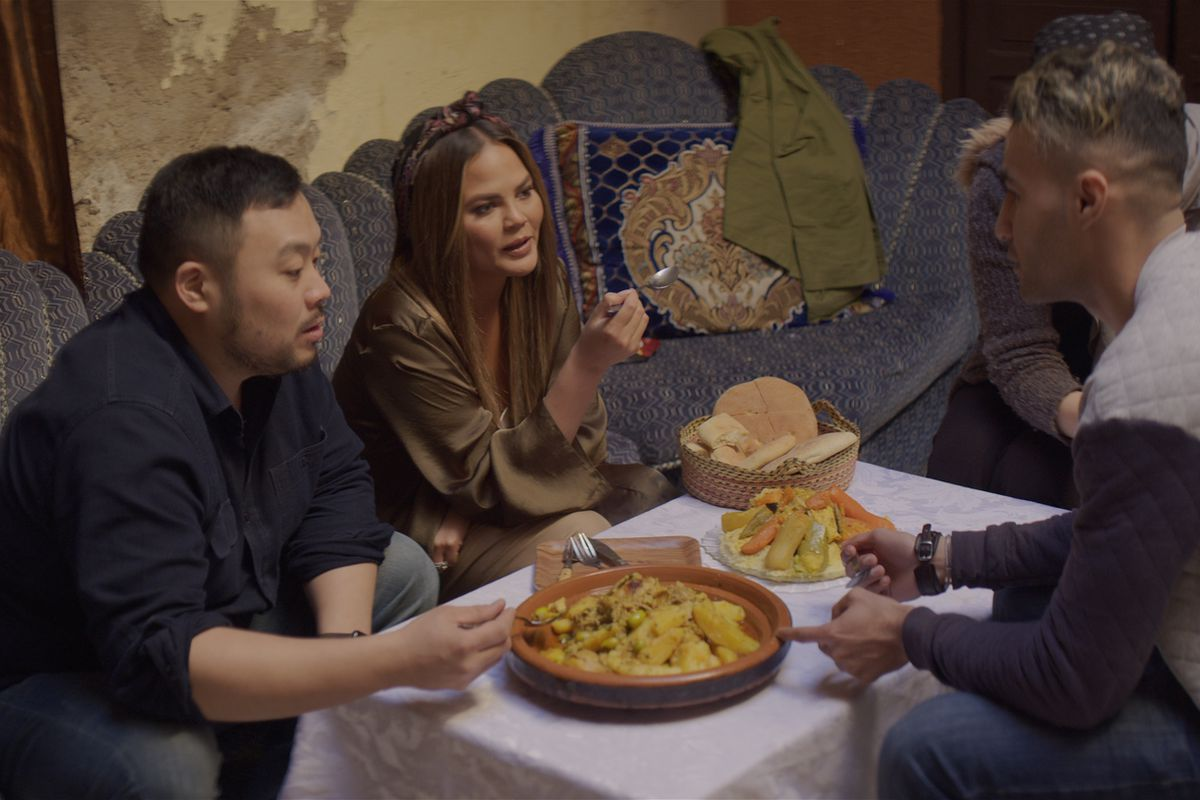 David Chang and Chrissy Teigen eat dinner in a local Moroccan family's home.