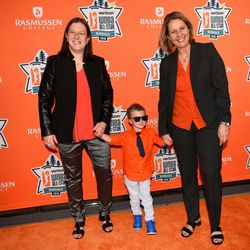 WNBA Minnesota Lynx head coach Cheryl Reeve, right, with her wife, Lynx team vice president Carley Knox, and their son Oliver, on the orange carpet.