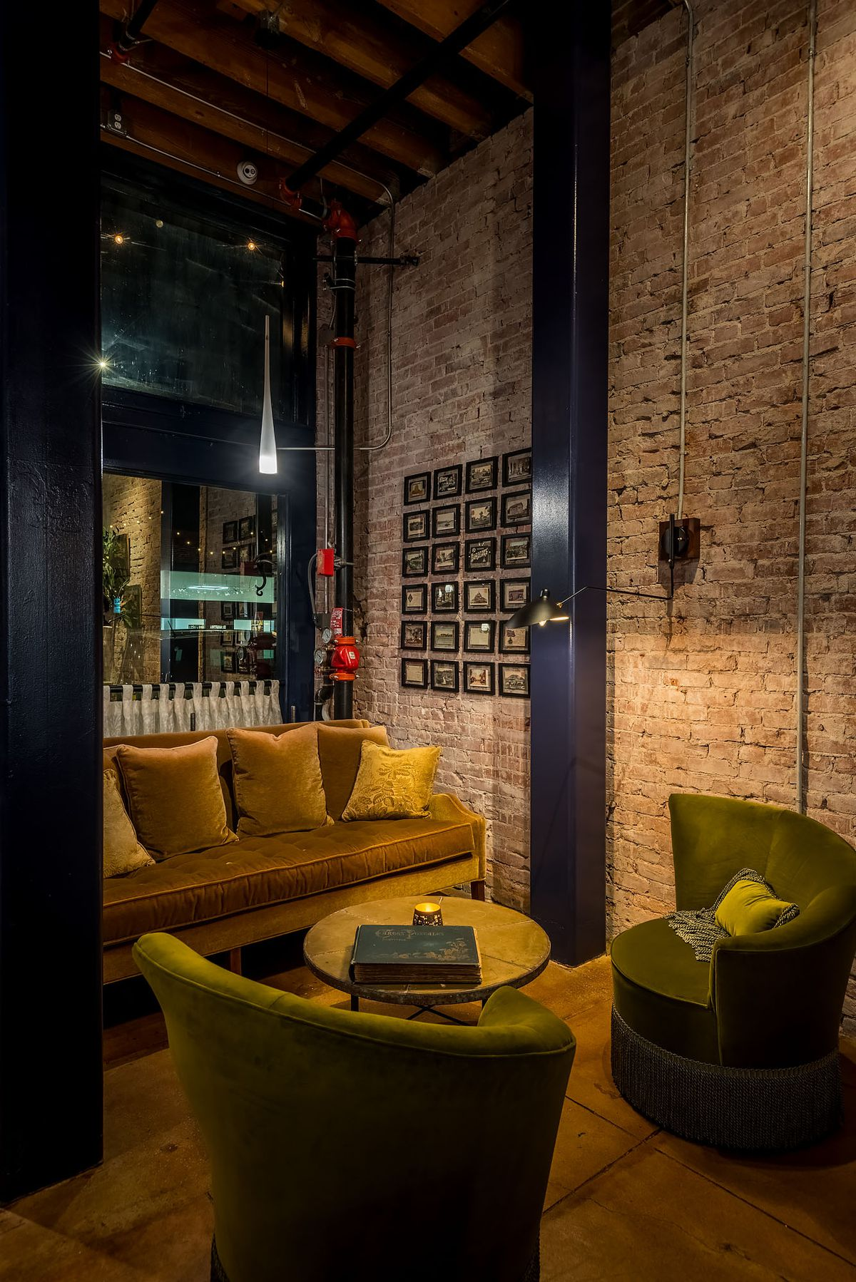 A tufted lounge area surrounded by brick.