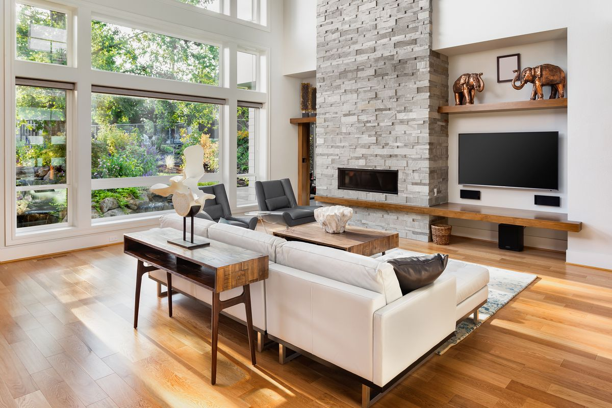 Living room interior with hardwood floors and fireplace.