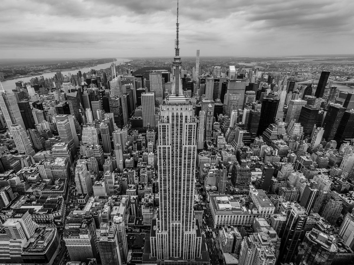 The Empire State Building and the tops of skyscrapers and buildings of New York City.