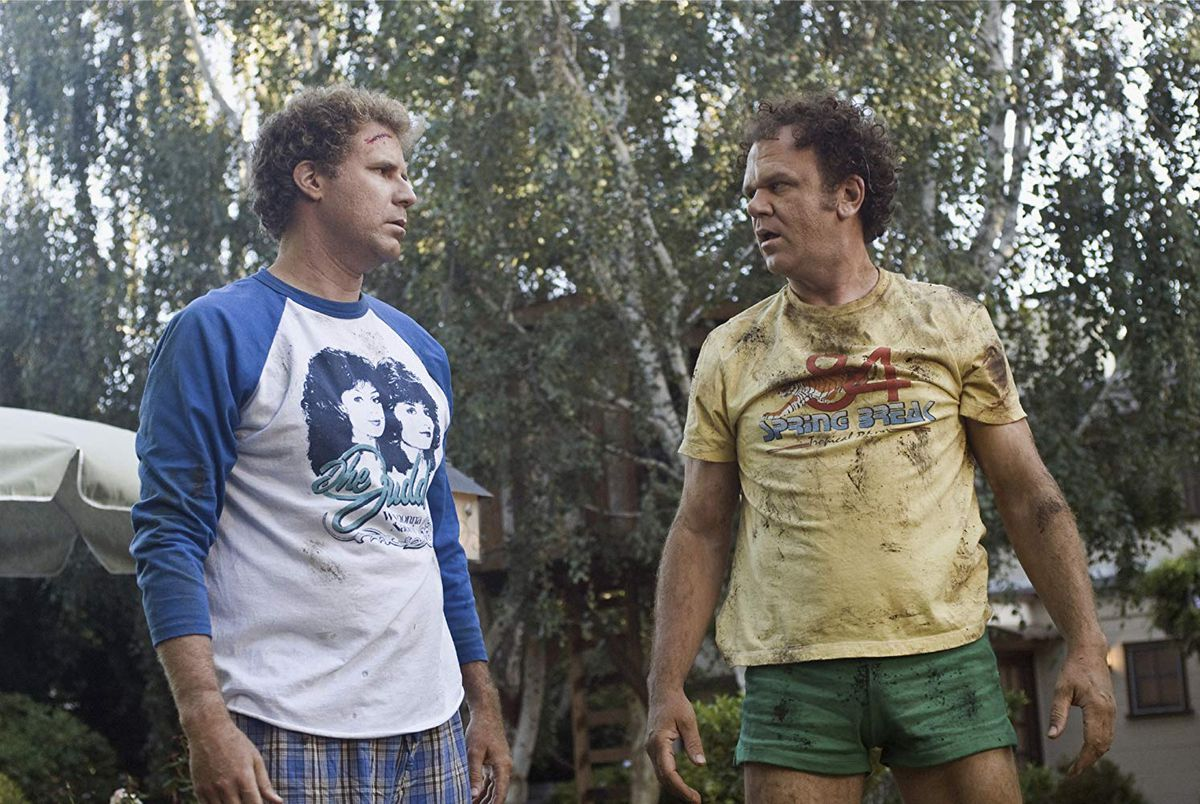 Ferrell and Reilly covered in mud