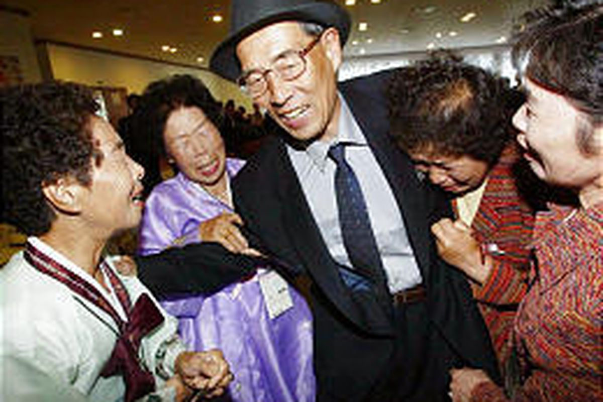North Korean Kim Jong Soo, center, meets his South Korean sisters during a reunion for separated families at a resort in North Korea Saturday. The sisters were among 453 South Koreans who visited North Korea to meet relatives for the first time in more th