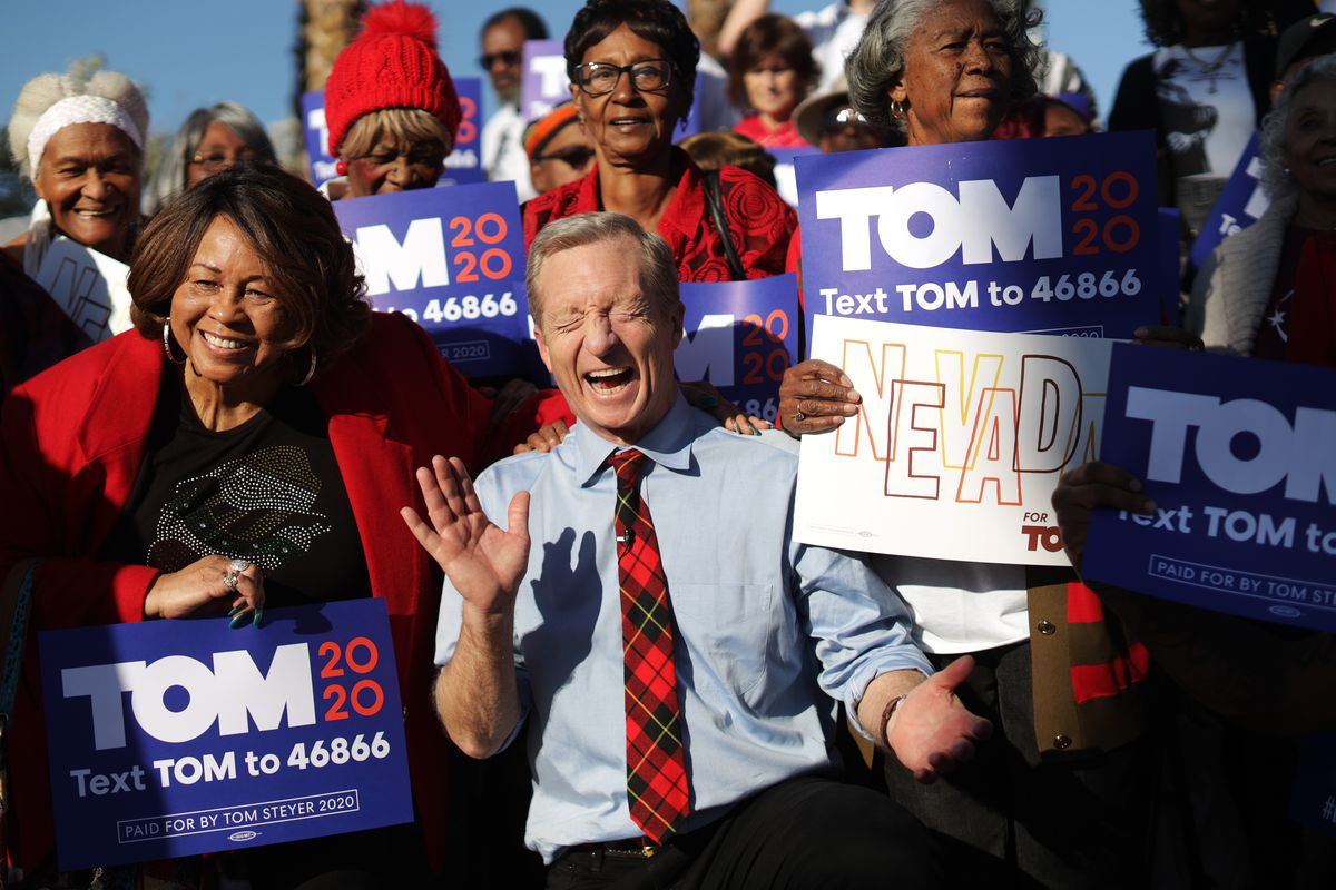 Democratic presidential candidate Tom Steyer reacts as he poses with supporters during a campaign event in Nevada.