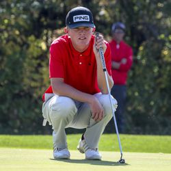 Jake Henrie, of Delta High School, lines up a birdie putt during the 3A boys state golf championship at Round Valley Golf Course in Morgan on Thursday, Oct. 8, 2020. Henrie finish in second place in the event.