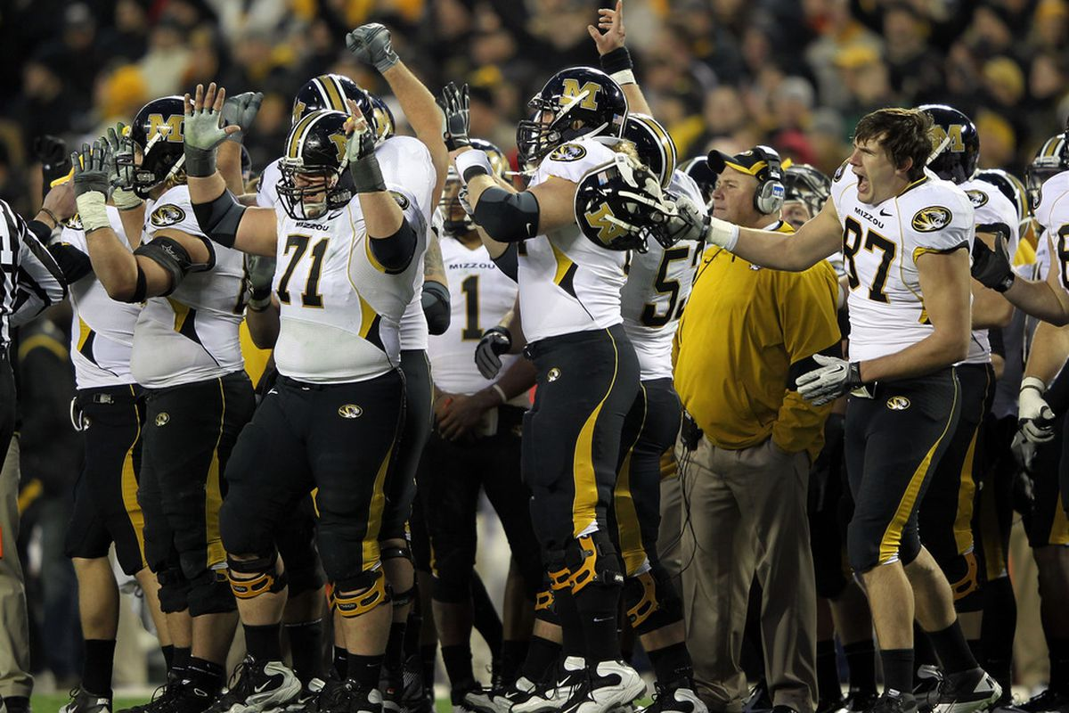 KANSAS CITY, MO - NOVEMBER 26:  The Missouri Tigers celebrate after a touchdown during the game against the Kansas Jayhawks on November 26, 2011 at Arrowhead Stadium  in Kansas City, Missouri.  (Photo by Jamie Squire/Getty Images)