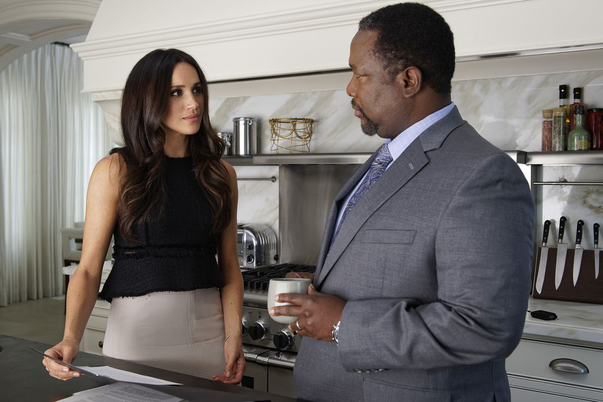 Markle as Rachel Zane on Suits, with Wendell Pierce as her father, Robert Zane.