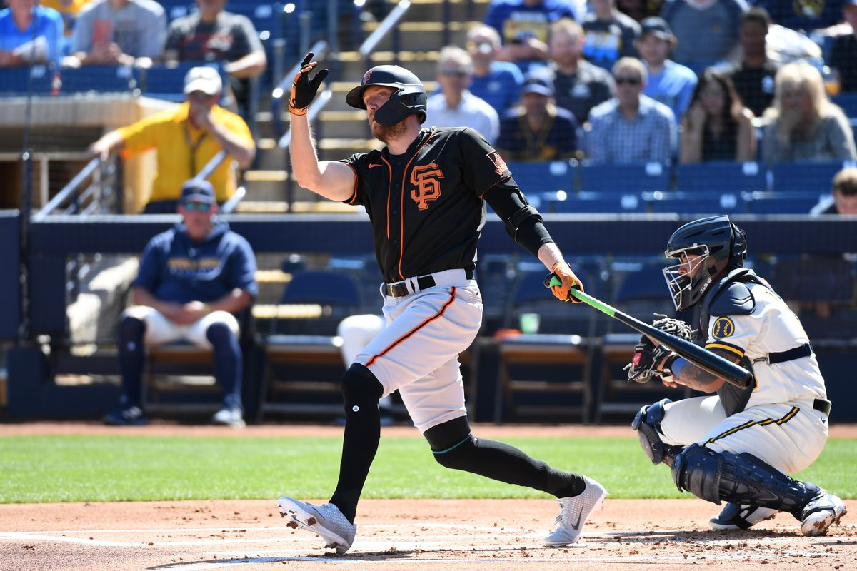 Hunter Pence of the San Francisco Giants follows through on a swing against the Milwaukee Brewers during a spring training game at American Family Fields of Phoenix on March 06, 2020 in Maryvale, Arizona.