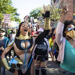 """Chicago drag performer Miss Toto (center) joins several black drag queens to lead the """"Drag March for Change"""" in the Boystown neighborhood on the North Side, Sunday afternoon, June 14, 2020."""
