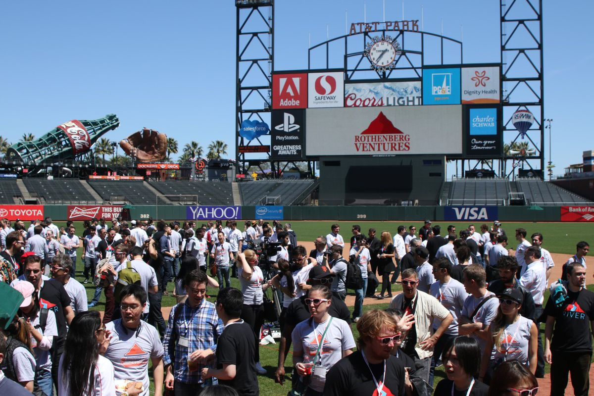 Founder Field Day attendees mill around finishing lunch on the field of AT&T Park, home of the Giants.