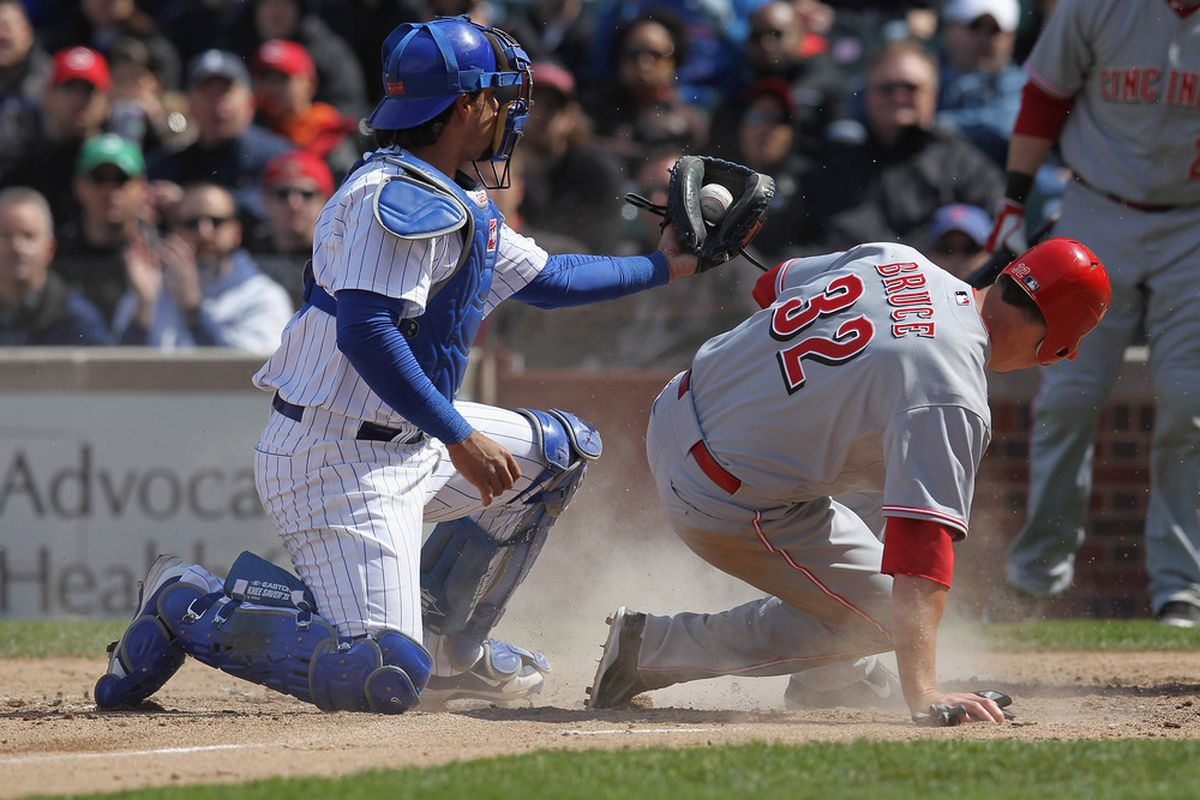 Geovany Soto of the Chicago Cubs shows the ball to the umpire after tagging out Jay Bruce of the Cincinnati Reds on a squeeze play at Wrigley Field in Chicago, Illinois. (Photo by Jonathan Daniel/Getty Images)