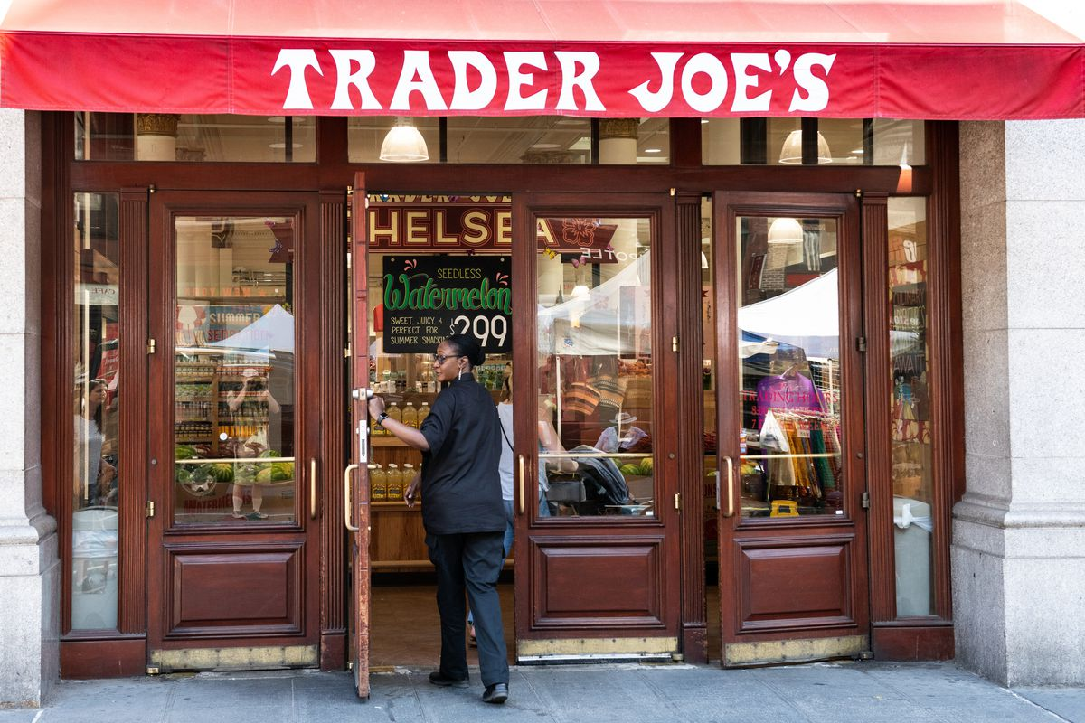 A man walks into a Trader Joe's grocery store