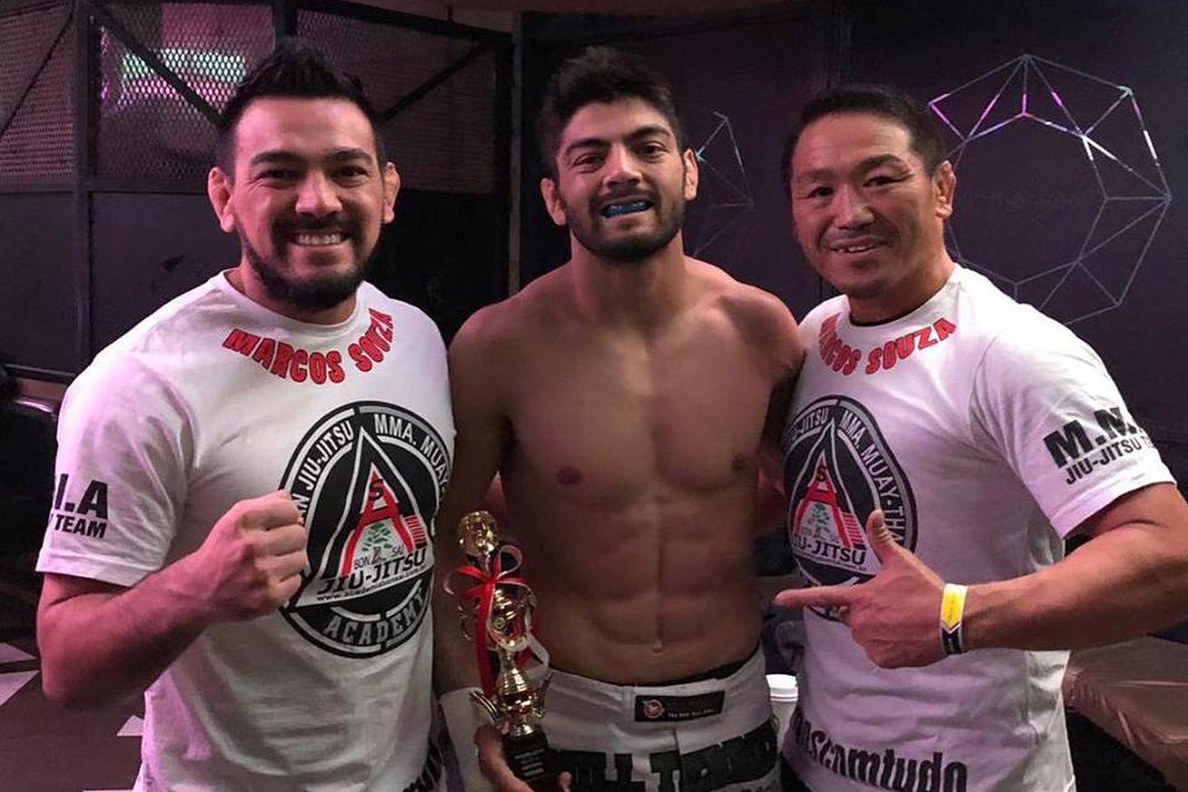 Jiu-jitsu expert Roberto Satoshi (center) holds a perfect 8-0 record in MMA.