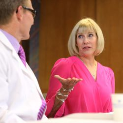 Dr. Brett Parkinson, a radiologist with the Breast Care Center at Intermountain Medical Center, left, listens as Linda Warner, a breast cancer survivor, talks about her diagnosis during a press conference in Murray on Monday, Oct. 9, 2017, as cancer researchers from Intermountain Medical Center and the Intermountain Precision Genomics Program launch a cutting-edge genomics breast cancer study for Utah women. The study seeks to determine whether specific blood tests that look for DNA from cancer tumors can be used to complement screening mammography to improve the way breast cancer is diagnosed.