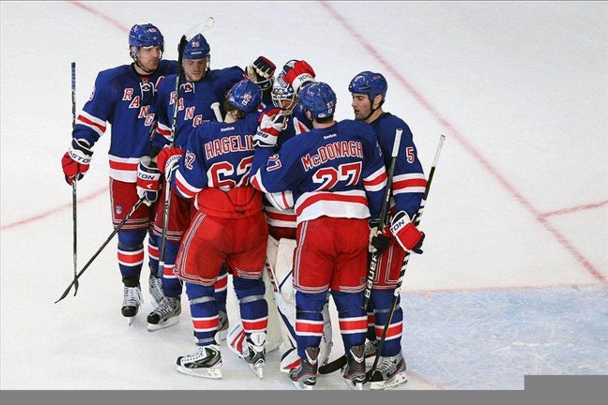 Mar 13 2012; New York, NY, USA;  New York Rangers celebrate their win against the Carolina Hurricanes at Madison Square Garden.  Rangers won 4-2.  Mandatory Credit: Anthony Gruppuso-US PRESSWIRE