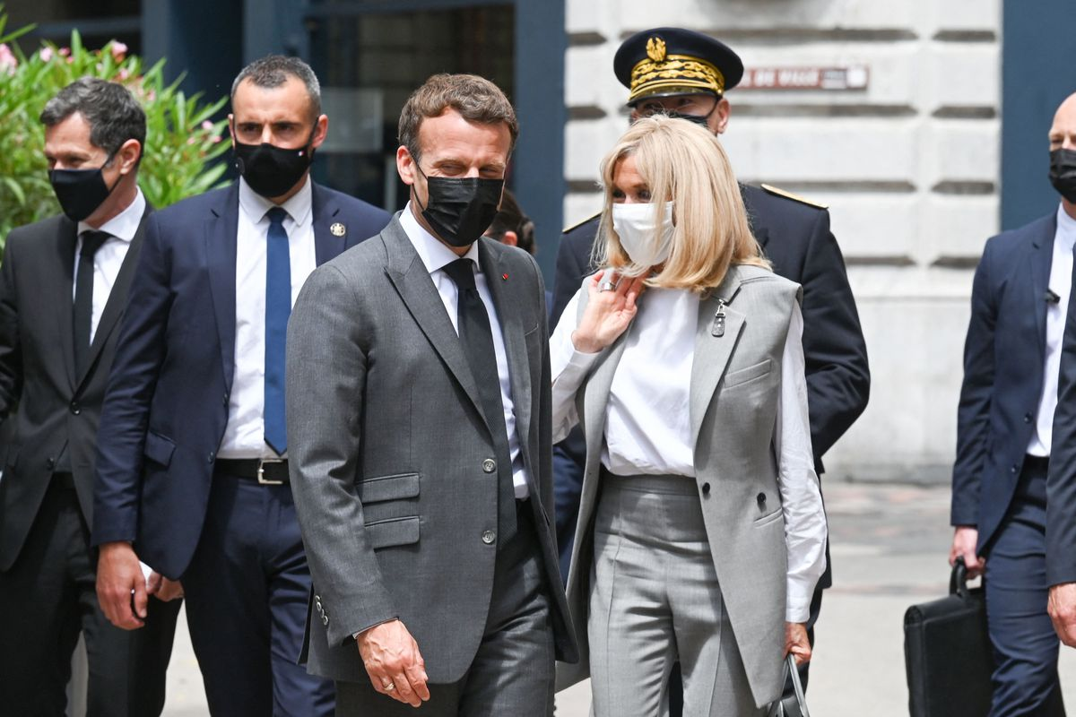 French President Emmanuel Macron walks next to his wife Brigitte Macron before a lunch in Valence, on June 8, 2021, during a day visit in the French southeastern department of Drome, the second stage of a nationwide tour ahead of next year's presidential election. - A bystander slapped Emmanuel Macron across the face during a trip to southeast France on June 8 on the second stop of a nation-wide tour.