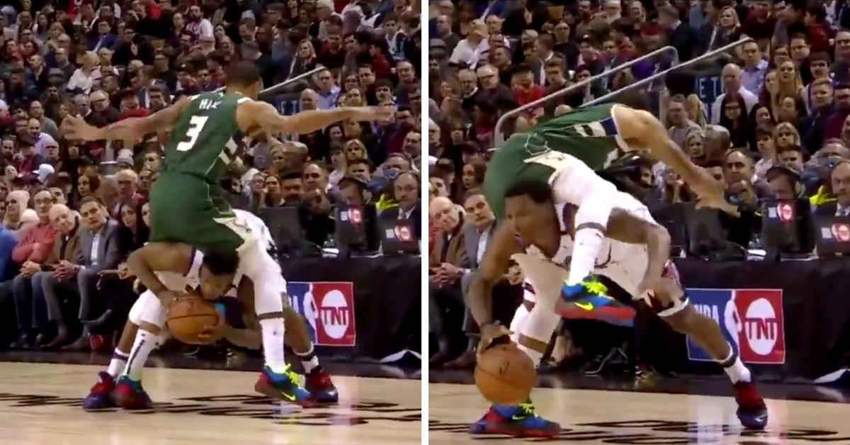 Kyle Lowry tried to dribble his whole body underneath George Hill's legs for some reason