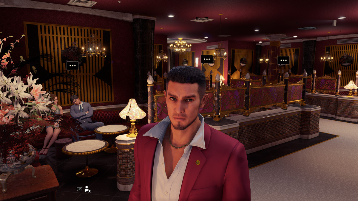 Yakuza: Like a Dragon protagonist Ichiban standing inside of a maid café