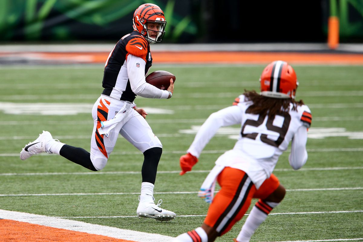 Cincinnati Bengals quarterback Joe Burrow (9) carries the ball during the fourth quarter of a Week 7 NFL football game against the Cleveland Browns, Sunday, Oct. 25, 2020, at Paul Brown Stadium in Cincinnati.