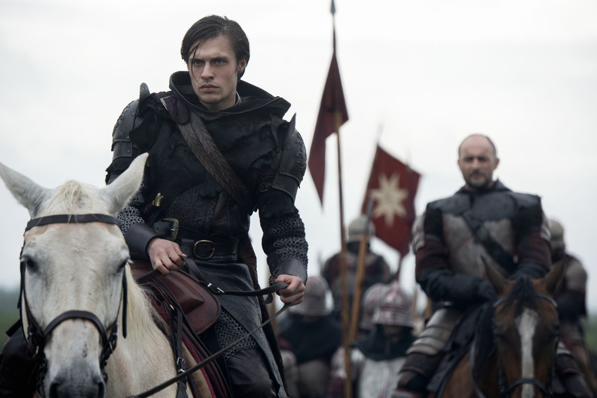 a clearly evil young man rides a white horse