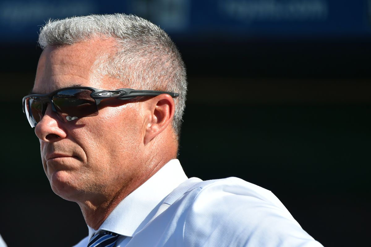 General manager Dayton Moore of the Kansas City Royals watches batting practice prior to a game against the Baltimore Orioles at Kauffman Stadium on August 30, 2019 in Kansas City, Missouri. Owner David Glass has agreed to to sell the team to a group led by Kansas City business man John Sherman for an estimated $1 billion.