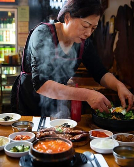 Monica Lee assembles dishes at Beverly Soon Tofu.