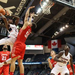 UConn's Terry Larrier (22) goes up for a shot over a Boston University defender.