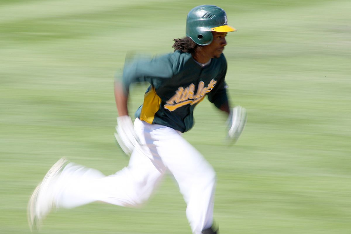 Mar 20, 2012; Phoenix, AZ, USA; Oakland Athletics second baseman Jemile Weeks (19) runs out a grounder during the fifth inning against the Chicago Cubs at Phoenix Municipal Stadium.  Weeks was out on the play. Mandatory Credit: Jake Roth-US PRESSWIRE