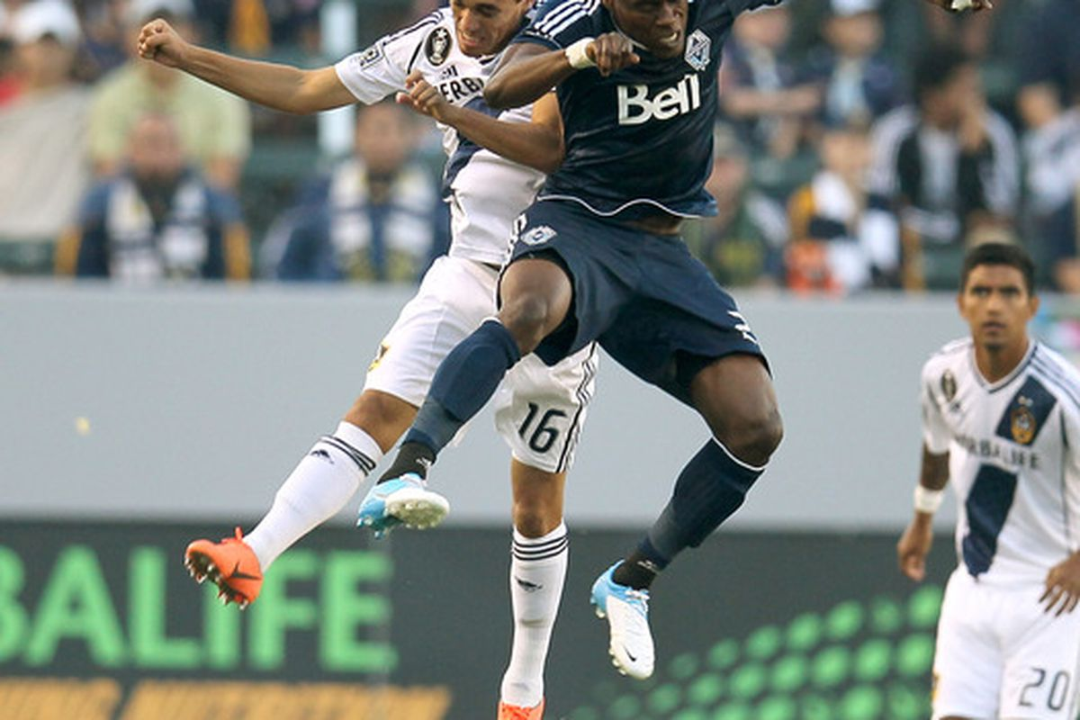 CARSON, CA - JUNE 23: Gershon Koffie #28 of the Vancouver Whitecaps jumps for the ball against Hector Jimenez #16 of the Los Angeles Galaxy at The Home Depot Center on June 23, 2012 in Carson, California.  (Photo by Stephen Dunn/Getty Images)