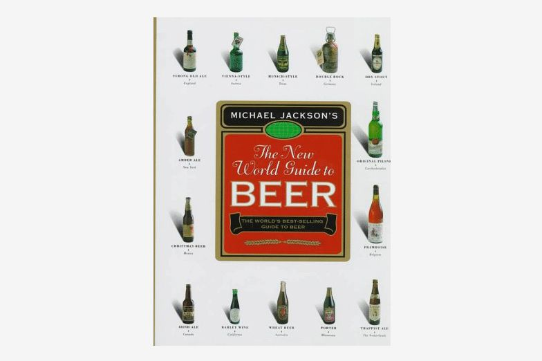 "The cover of ""The New World Guide to Beer"" with assorted bottles of beer labeled on a white background"