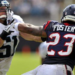Houston Texans running back Arian Foster (23) stiff-arms Jacksonville Jaguars middle linebacker Paul Posluszny (51) to get extra yardage during the second half of an NFL preseason football game on Sunday, Sept. 16, 2012, in Jacksonville, Fla. The Texans defeated the Jaguars 27-7.