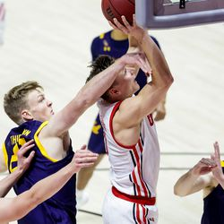 Utah Utes guard Pelle Larsson (3) goes to the hoop ahead of California Golden Bears forward Kuany Kuany (13) during the game at the Huntsman Center in Salt Lake City on Saturday, Jan. 16, 2021.