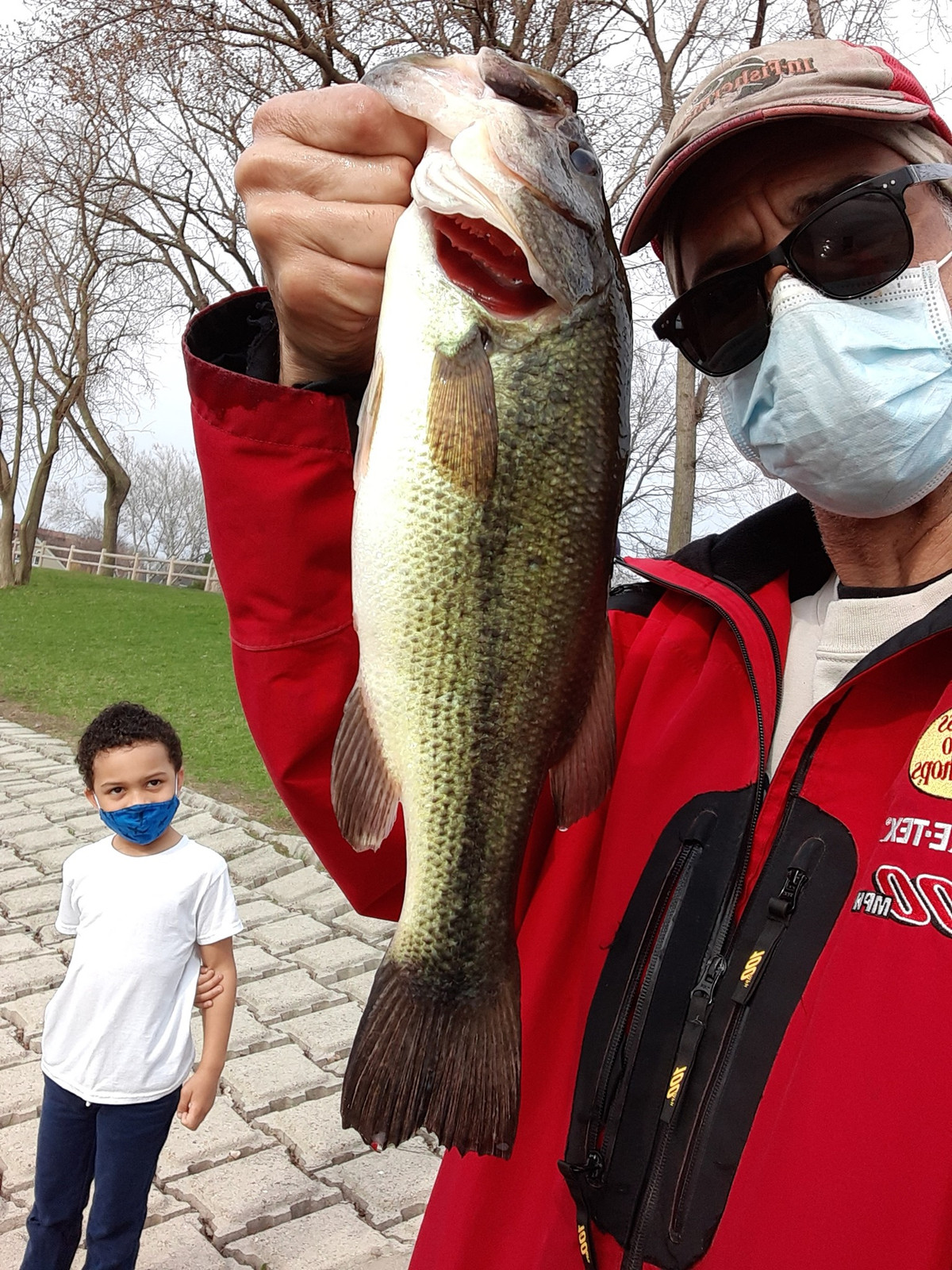A kid checks out Rob Abouchar with a largemouth bass from Twin Lakes. Provided photo