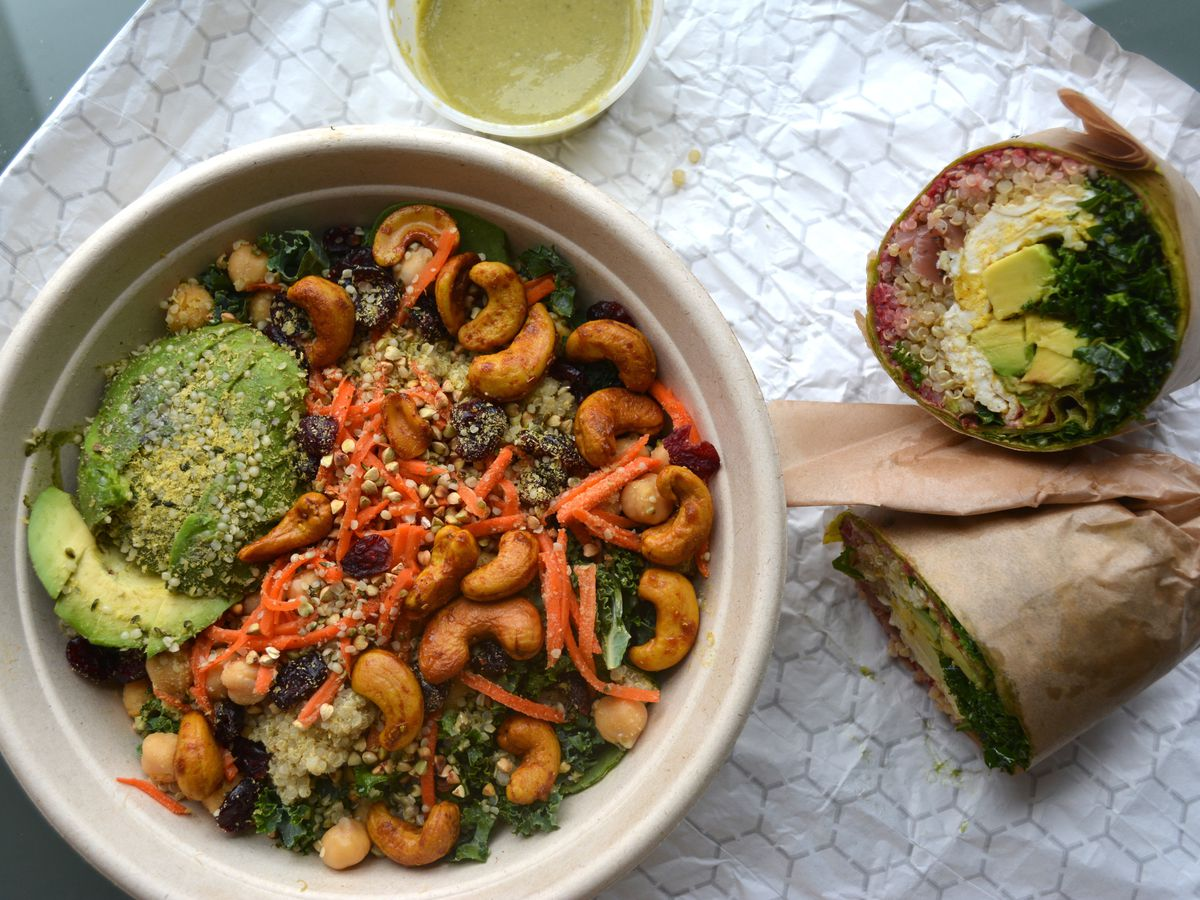 Vegan kale-avocado-cashew salad and wrap with quinoa, egg, and kale