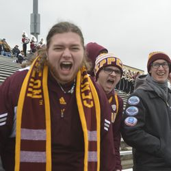 CMU fans react to a Tyrone Scott touchdown in the first quarter.