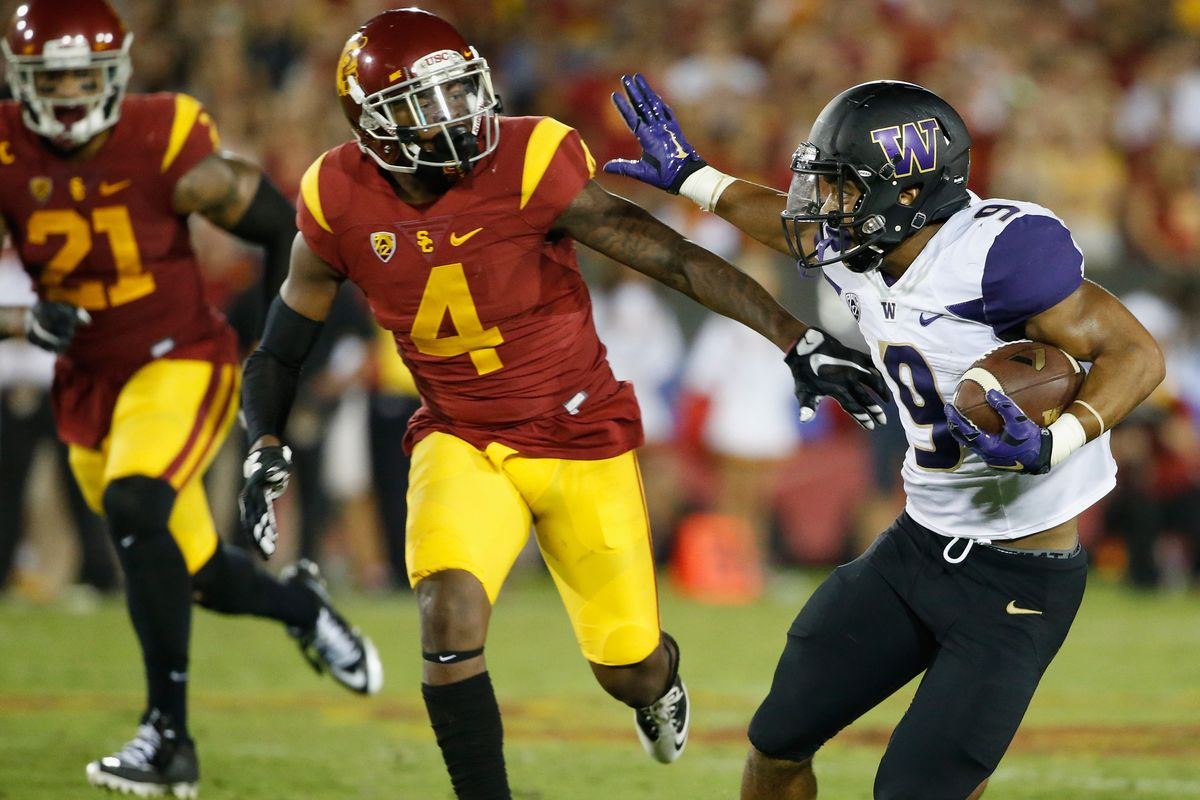 Souther Cal's Su'a Cravens attempts to stop a Husky ballcarrier
