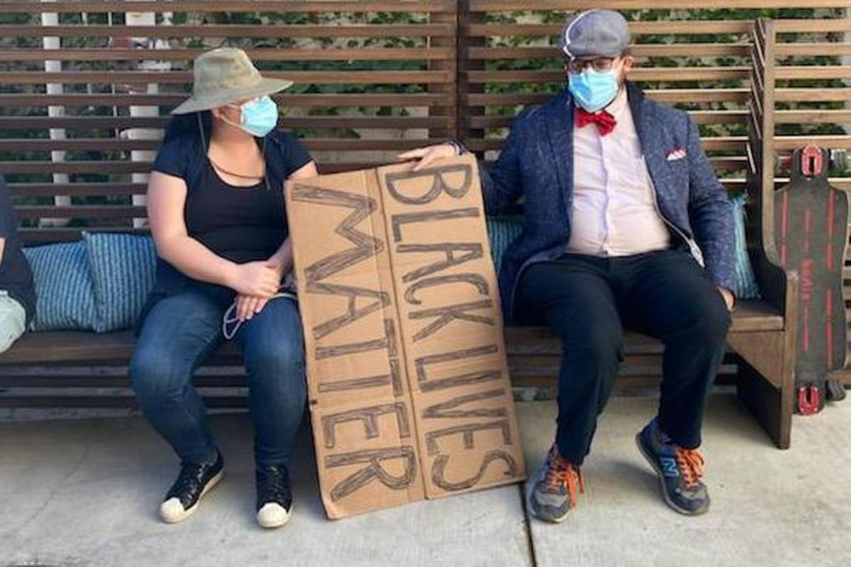 Protesters rest at Antica Pizzeria in Hollywood during protests