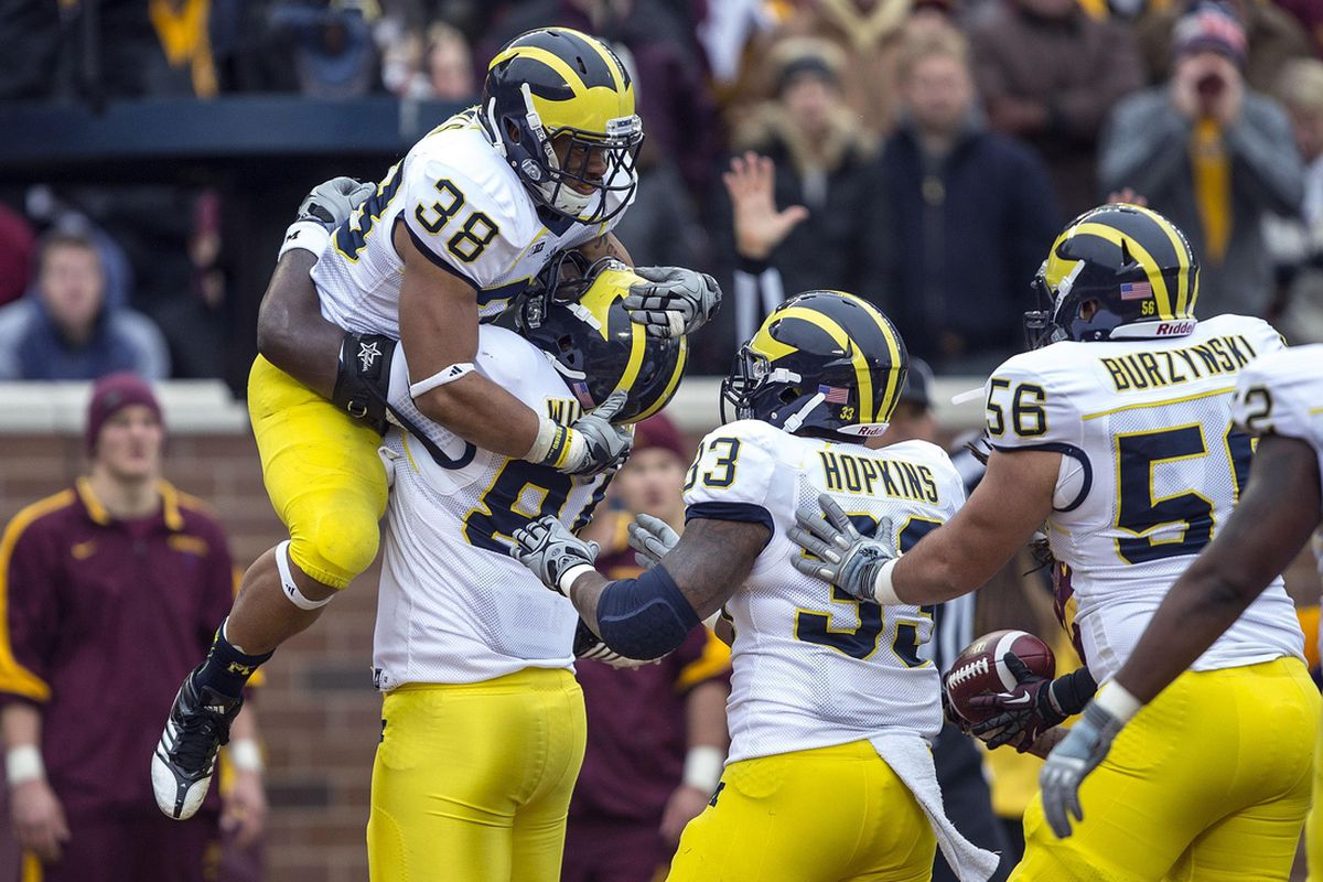 Nov 3, 2012; Minneapolis, MN, USA: Michigan Wolverines running back Thomas Rawls (38), tight end Mike Kwiatkowski (81), and running back Stephen Hopkins (33) celebrate a touchdown in the first half against the Minnesota Golden Gophers.