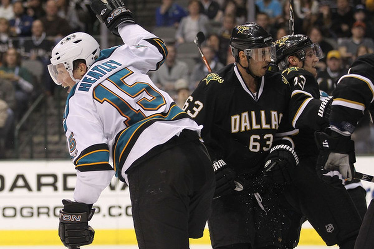 DALLAS, TX - MARCH 15:   Dany Heatley #15 of the San Jose Sharks celebrates a goal against the Dallas Stars at American Airlines Center on March 15, 2011 in Dallas, Texas.  (Photo by Ronald Martinez/Getty Images)