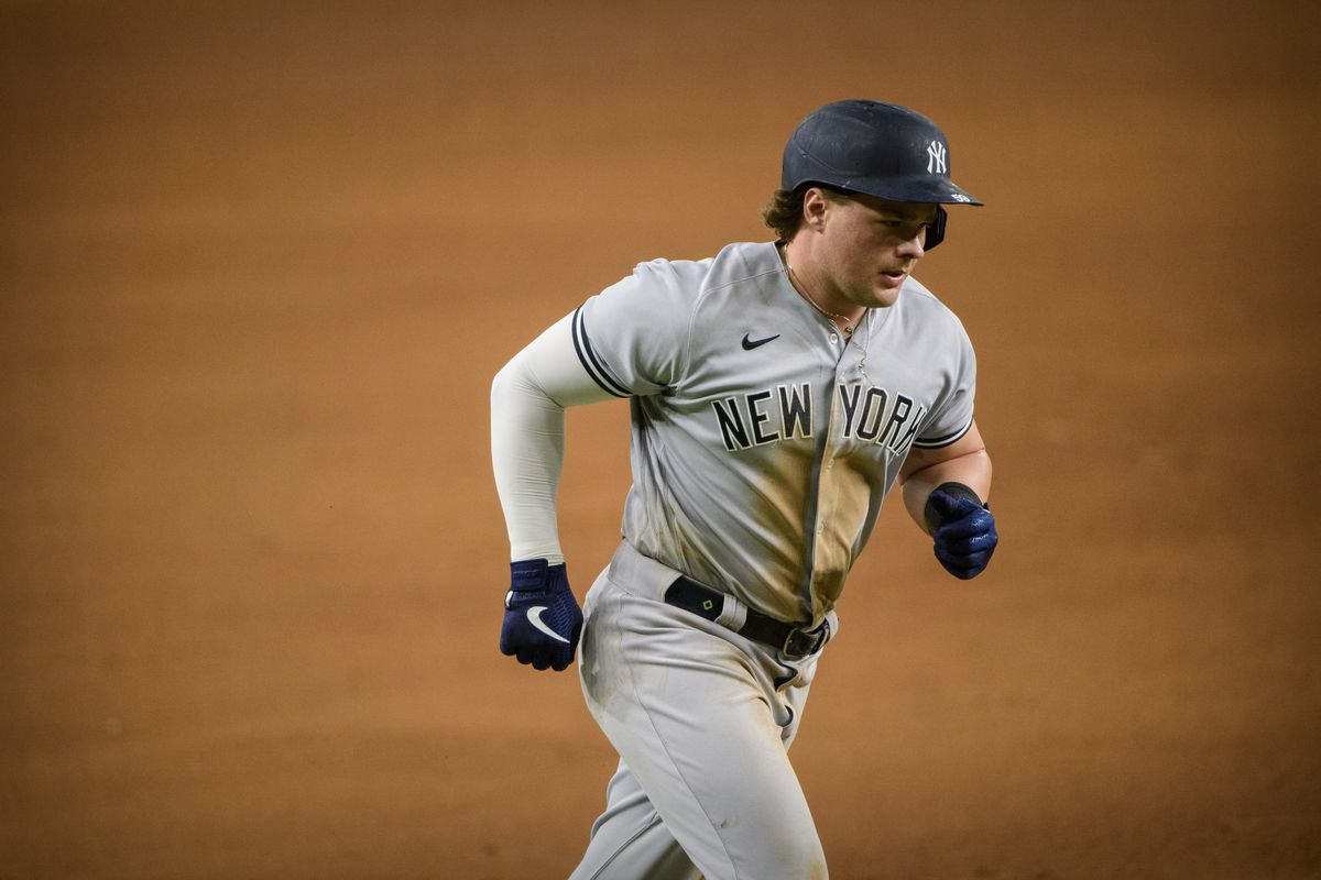 New York Yankees first baseman Luke Voit rounds the bases after hitting a home run against the Texas Rangers during the game at Globe Life Field.