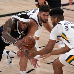 Denver Nuggets' Torrey Craig (3) competes for control of the ball against Utah Jazz's Georges Niang, center, and Juwan Morgan (16) during the first half an NBA first round playoff basketball game, Tuesday, Sept. 1, 2020, in Lake Buena Vista, Fla.
