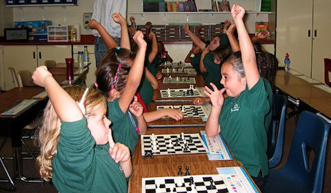 Students playing chess at PODER Academy.
