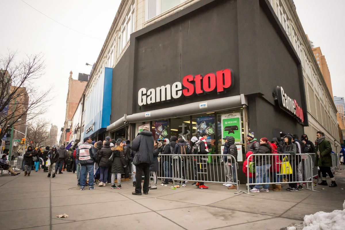 line of customers in front of a GameStop store